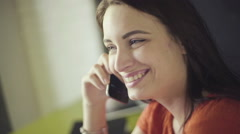 Portrait of attractive brunette woman talking on mobile phone at home Stock Footage