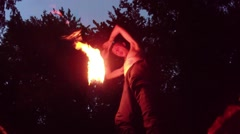 A Person With Naked Torso Making Fire Performance at Night View From the Bottom Stock Footage