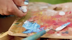 Artist mix color oil painting Stock Footage