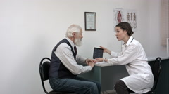 Senior Man Discussing Results With Doctor On Digital Tablet Good News Stock Footage