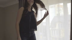 Funny happy brunette girl with long hair jumping, spinning and having fun in bed - stock footage
