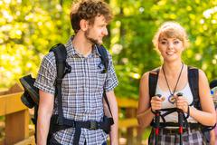 Couple backpacker hiking in forest pathway Stock Photos
