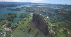 Aerial descending down with the Piedra del Penol in the foreground Stock Footage