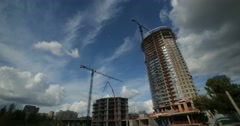 Time-lapse, skyscraper under construction. Tower cranes - stock footage