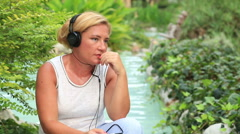 Woman with headphone listen to music outdoor Stock Footage