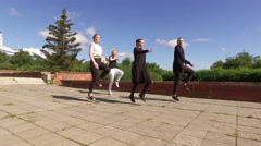 The art of dance. Group of four young people dancing in the street. 4K Stock Footage