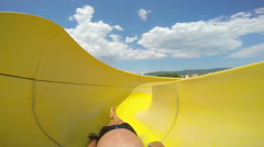 First-person view, the descent from the waterslide on holiday aqua park Stock Footage