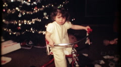 a little girl gets a tricycle on Christmas morning 3536-vintage film home movie Stock Footage