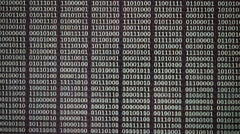 Changing binary code on LCD computer screen. Information and data concept. Stock Footage