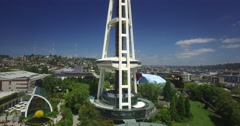 Aerial rising up to reveal the Seattle Space Needle Stock Footage