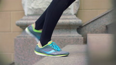 Sport woman legs walking up stairs. Closeup of legs in sport shoes move up Stock Footage