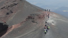 Tourists exploring Etna volcano craters Stock Footage