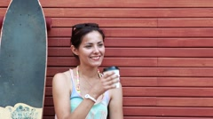Young cheeky girl drinking a ice coffee Stock Footage
