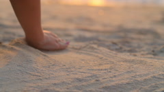 Hand plaing with sand on beach Stock Footage