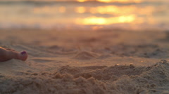 Plaing with sand on beach  Stock Footage