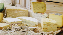 Cheese of different grades and different colors. beautifully decorated showcase Stock Footage
