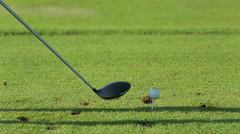 Golfer putting, selective focus on golf ball - stock footage