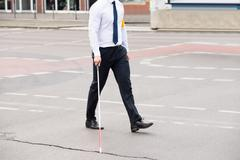 Blind Person With White Stick Walking On Street Kuvituskuvat