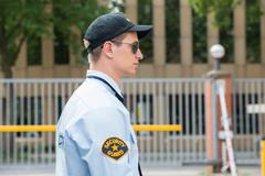 Side View Of A Young Male Security Guard In Uniform - stock photo