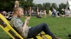 Man Eating Fresh Fruit Sitting on a Lounger Stock Footage