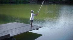 Fishing boy on a pier Stock Footage
