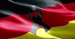 Pray for germany, waving germany country flag color background with black ribbon Stock Footage
