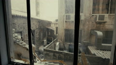 4K Window view at collapsed, half-ruined buildings in ghetto city block Stock Footage