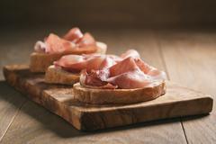 Simple ciabatta slices with speck ham Stock Photos