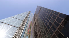 Glass Office Buildings in City and Cheese Grater Stock Footage