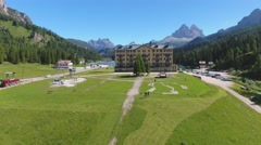 Three Peaks of Lavaredo from Misurina, aerial view Stock Footage