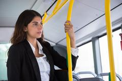 Contemplated Young Businesswoman Traveling By Public Transport Stock Photos