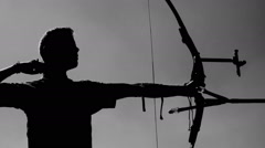 Target Archery: Young Archer Backlight, Practice in Field, Slow Motion Stock Footage
