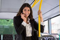 Happy Young Businesswoman Talking On Smartphone While Traveling By Public Tra Stock Photos