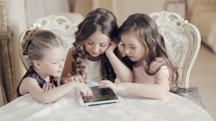 Girls watching photos in the tablet and wonder Stock Footage