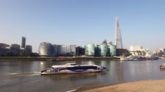 London Thames with Shard and Passenger Boat Stock Footage