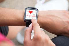 Close-up Of Human Hand Wearing Smart Watch Showing Heartbeat Rate Stock Photos