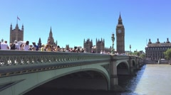 LONDON - MAY 2015: Westminster Bridge over Thames. London attracts 30 million Stock Footage