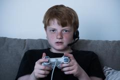 Portrait Of Boy With A Joystick Playing Videogames At Home Stock Photos