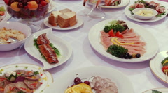 Salads, meat, fish, fruit, strawberries on table. Stock Footage