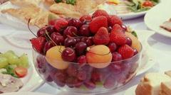 Tasty fruit - peaches, cherries, cherry on table. Stock Footage