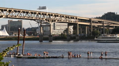 Portland Oregon - swimmers on pier on Willamette River with huge cruise ship Stock Footage