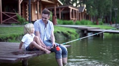Family fishing on pier outdoors Stock Footage
