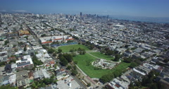 Aerial pushing over Mission Dolores park to San Francisco skyline Stock Footage