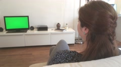 Young Woman Watches Green Screened TV in Living Room, Dolly Shot 4k Stock Footage