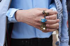 Woman with clasped hands wearing rings, close up detail Stock Photos