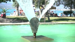 Fountain and seaside at sunny summer day Stock Footage