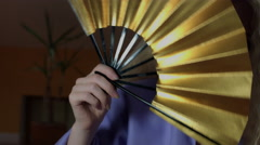 4k Fantasy Shot of a Fairy Posing with a Golden Fan, close shot Stock Footage