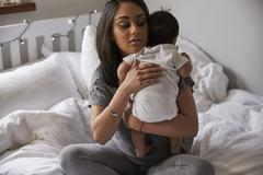 Mother Winding Baby Boy After Feed Stock Photos