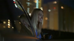 Beautiful girl outside of the window in motion of car on background of building Arkistovideo