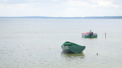 Fisher boats docked at a lake shore Stock Footage